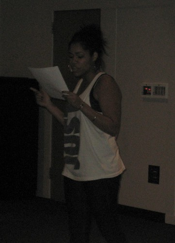 Anja Francesca reads from her poem at the Black Student Union's Expressions event on Tuesday, which incorporates spoken word, music, and poetry.  Photo by Akima Brackeen/Foghorn