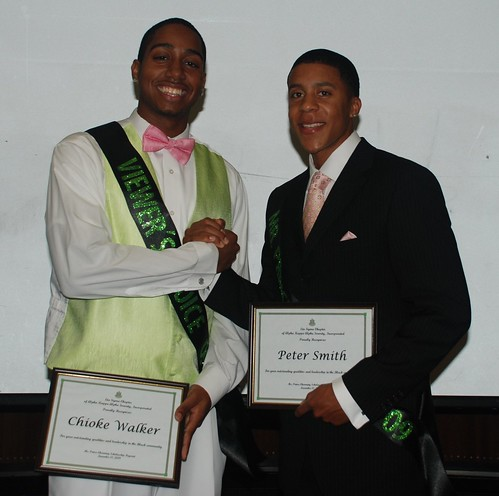 Chioke Walker congratulates Prince Charming pageant winner Peter Smith.  Photo by Akima Brackeen/Foghorn