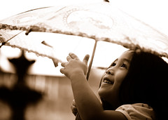 Light of my life (.I Travel East.) Tags: life light love smile rain sepia umbrella fun child candid cara daughter batonrouge lousiana papa myprecious lightofmylife mylittlegirl batonrougelouisiana