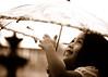 Light of my life (.I Travel East.) Tags: life light love smile rain sepia umbrella fun child candid cara daughter batonrouge lousiana papa myprecious lightofmylife mylittlegirl batonrougelouisiana