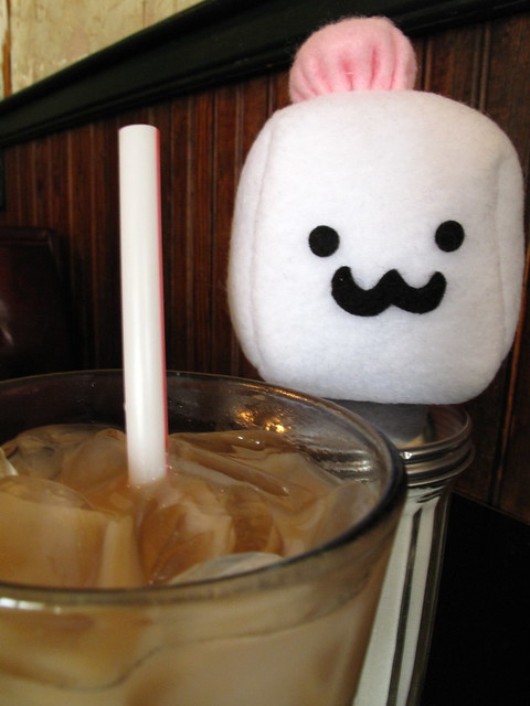 Tofu Baby has some iced coffee.