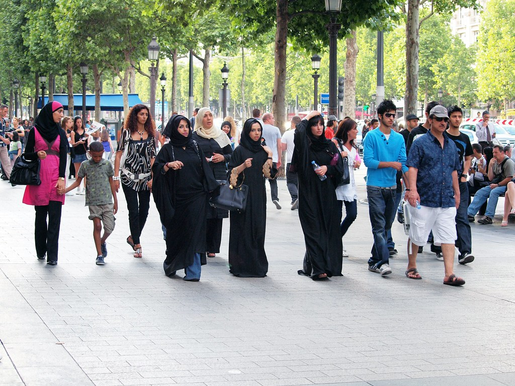 Muslim Women Stroll Down the Champs Elysees