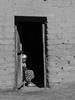 Old Woman at Sun (Daniel Coitiño) Tags: monocromo mujer vieja choza rancho puerta pared sol