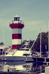 lighthouse (share your widsom) Tags: ocean trees sunset ohio red sun lighthouse brick beach water graveyard leaves june virginia sand focus tombstone southcarolina ground glove summertime yachts 2009 summervacation yellowfever westvirgina hiltonheadisland canonrebelxsi