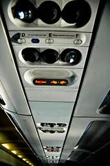 148/365 Seatbelts On, No Smoking (rakeif) Tags: plane airplane nikon nikond70 d seat row aeroplane ceiling f e illegal nosmoking airvent seatbelt pun stupidpun project365 seatbeltson iimmediatelyregrettedsayingthatbecauseitwassolame