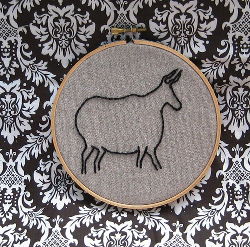 Cave-painting inspired stitched steer