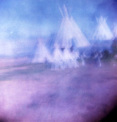 Recollections of Spirit Memory (Dead  Air) Tags: sky blur grass manipulated washington holga indian surreal spirits nativeamerican overexposed ghosts armageddon sciencefiction campground toppenish teepees exposures culturalappropriation postapocolyptic spiritualappropriation yakamatribalcenter