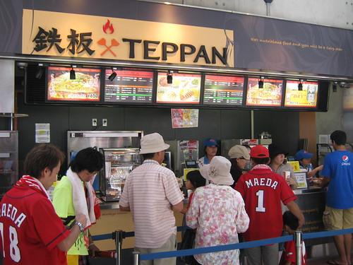 Dave buying some okonomiyake at a ballpark vendor.
