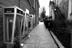 N-O-T-L Phonebooths (Craig's Making Pictures) Tags: blackandwhite bw ontario black alley phonebooth perspective niagara niagaraonthelake notl oldnew sonyalphadslra200