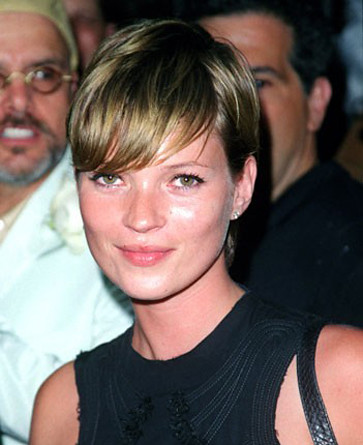 I actually like her better in short hair (like Linda Evangelista),