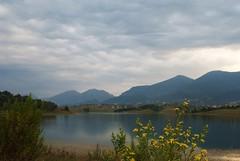 angry sky, peaceful lake (kosova cajun) Tags: mountains landscape cloudy balkans albania yellowflowers sauk tirana shqipri peisazh shqipria tiran southeasterneurope dajtimountain mtdajti maliidajtit liqeniifarks farkalake fark