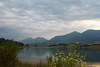 angry sky, peaceful lake (kosova cajun) Tags: mountains landscape cloudy balkans albania yellowflowers sauk tirana shqipëri peisazh shqipëria tiranë southeasterneurope dajtimountain mtdajti maliidajtit liqeniifarkës farkalake farkë