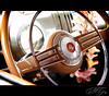 Cars & Coffee (Marcie Gonzalez) Tags: auto show california lighting county old flowers light orange hot flower color detail reflection classic cars coffee colors up car wheel metal vintage reflections automobile colorful paint close steering natural display plumeria antique steel parts painted board details tan peach automotive southern part chrome dash controls classics coloring rod antiques dashboard collectors oc upclose rods section shinny plumerias automobiles irvine collecting collector metals classy detailing chromed chroming carsandcoffee colllect