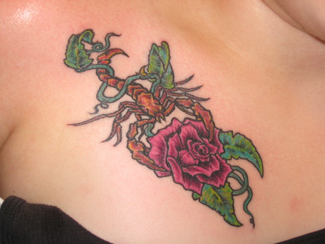 Scorpion wraped in vine holding Rose. Tattoos By Sergio: