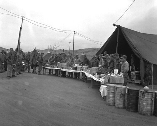 Chow line for 1950 Thanksgiving dinner of 1st Signal at Hamhung, North Korea during the Korean War.