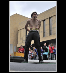 Suck In That Gut (andrewfuller62) Tags: 35mm australia tasmania streetperformer contortionist hobart omg busking tennisracquet thatsincredible salamancamarkets workingthecrowd nikkor1735mmf28 howdoeshedoit icantlookanymore nikond300 nikoncapturenx2