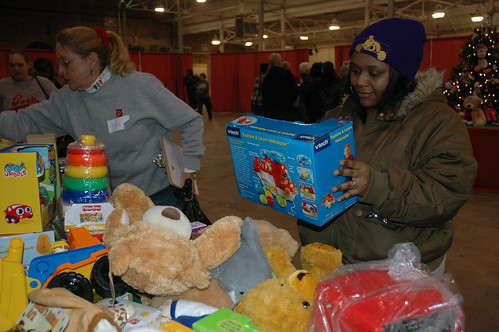Parents shop at The Salvation Armys Kids Toy Shop for gifts for their children this Christmas.
