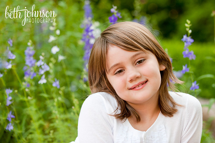 little girl in front of flowers at maclay gardens