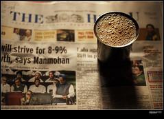 Tea and newspaper.... (Sandeep Somasekharan) Tags: morning newspaper tea 50mmf18 normallens breakfasttable 50mmprime sunlightnikonnikord80sandysandeepsomasekharanmysore sandyclix