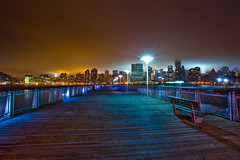 153/365 : Shades of Brooklyn (13thWitness) Tags: new wood york city nyc longexposure blue red ny skyline brooklyn night bench lights pier cool warm downtown cityscape shot nightshot manhattan horizon midtown explore queens hues empirestatebuilding tones frontpage epic longislandcity goldenratio ihatetagging imsorryevan