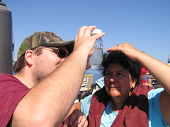 Jeremy and Carmen check out the plankton Russell collected. ~photo Jennifer Yauck