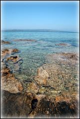 As far as the eye can see... (FutureMad) Tags: blue sea sky sun sunshine clouds canon island eos seaside rocks sardinia colours antioco 400d estremità