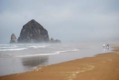 Haystack Rock (kmrphotography) Tags: ocean summer beach oregon coast sand rocks pacificocean cannonbeach haystackrock monolith seastack rockformation everythingisbeautifulweekendsareforthread sept22009 20090903342