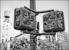 NYC - 15 ( CHRISTIAN ) Tags: nyc newyorkcity urban blackandwhite bw eastvillage ny newyork trafficlights blackwhite noiretblanc manhattan stickers nb metropolis cistern noirblanc urbain megapolis mtropole citerne autocollants feuxdecirculation mgapole