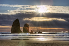 west coast (richietown) Tags: ocean sunset sun topv111 clouds lens flare haystack needles cannonbeach richietown