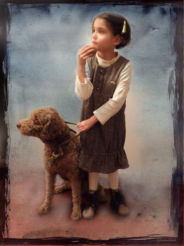 Niña con una Perra