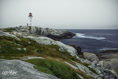 Morning at Peggy's Cove (wilbias) Tags: canada morning water blue cloudy lighthouse ocean rocks point atlantic cove foggy nova scotia peggys 6 am