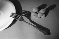 fork and grapes (mona_dee) Tags: still life stilllife fork grapes tabletop blackwhite bw