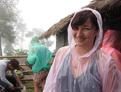 A rainy smile (MastaBaba) Tags: trip travel water smile face rain trekking trek thailand seethrough raincoat tic niamh 2009 lahu 20090715 20100304