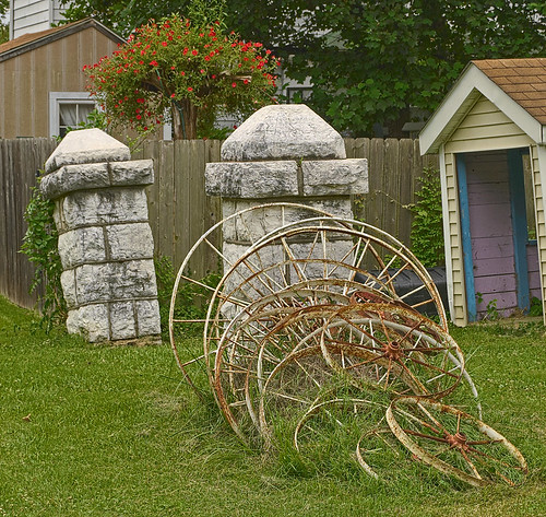 Wagon wheels and decorative stonework, in Kimmswick, Missouri, USA