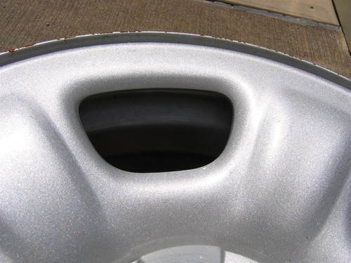 This is a close-up shot of a styled steel wheel. It may look like aluminum at first sight but this is really just a painted steel wheel. You can see a little rust around the edges, this is another way to tell that it is steel and not aluminum.