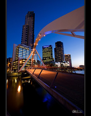 Eureka Tower (Dale Allman) Tags: longexposure bridge reflection water skyline architecture skyscraper star australia melbourne wideangle victoria casino 1740 eurekatower crowncasino yarrariver canon5dmkii trinitypedestrianbridge