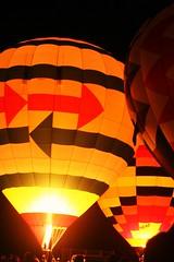 Balloon Glow No. 9 (hgill21) Tags: pink orange color night balloons fire glow hotairballoons checks