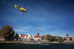 The Sound of Rescue (zykloid) Tags: blue sky people rescue water river germany boat chopper europe cathedral helicopter doctor emergency airborne minster danube ulm mnster adac curch badenwuerttemberg fischerviertel