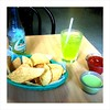 Chips, salsa, tomatillo sauce, and lime soda