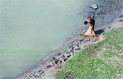 Fishing in the lake, Bandarban. (N A Y E E M) Tags: sun fishing fisherman negativescan midday bandarban chittagong nikonf6 fujicolorsuperia1600 hilltracts bogalake nayeemkalam afnikkor180mmf28dedif