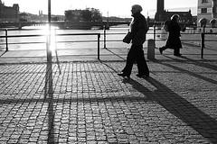 walking | Stockholm (arnabchat) Tags: street bridge light people water sunshine walking europe afternoon shadows shine sweden stockholm cobbled gamlastan sverige scandinavia chiaroscuro stoccolma 1740f4l duallight