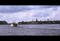 Stockholm (angelsgermain) Tags: city sky tower water ferry clouds buildings town cityscape sweden stockholm oldtown flickrestrellas