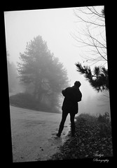 Tilt and shoot (andzer) Tags: road street wood autumn people bw white mist black tree fog lady forest leaf nikon shoot branch photographer path coat femme scout andreas explore curve tilt 2009 myfaves woma zervas andzer wwwandzergr