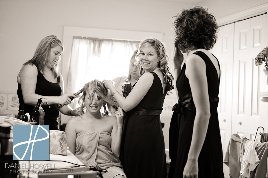 philina and bridesmaids helping before her madisonville wedding