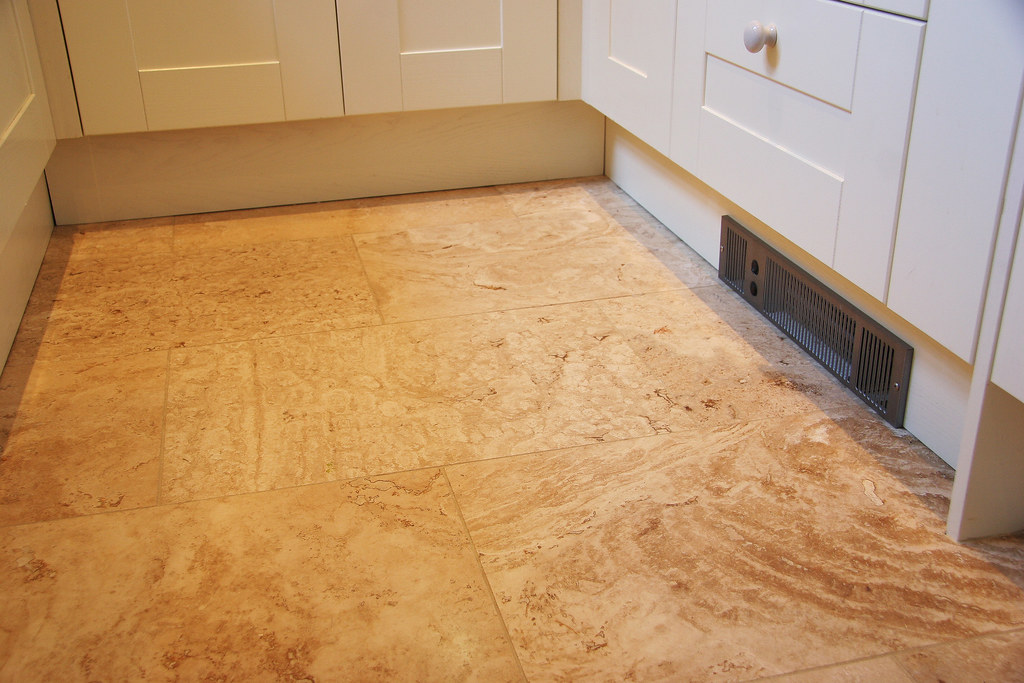 Limestone Travetine floor tiles and under plinth heater