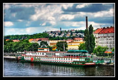 Prague River (Mike G. K.) Tags: city trees houses sky water architecture clouds photoshop buildings river geotagged hotel boat swan ship cityscape view prague hill softness praha row foliage explore processing czechrepublic greenery admiral effect frontpage vltava hdr slope botel photomatix 3exp geo:lon=14413344 geo:lat=50072903