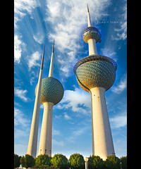 kuwait towers - a profile shot (alvin lamucho ) Tags: morning blue trees green water clouds perspective middleeast kuwait islamic moslem kuwaittowers 3towers 450d waterreservoirlightingalvin lamuchocanon