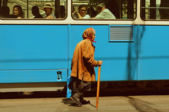 Daily commute.. (Che-burashka) Tags: street old people woman walking looking candid transport citylife streetphotography tram ukraine commute juxtaposition staring easterneurope socialcontrast vinnitsa 400d