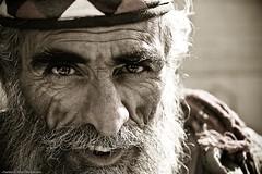 Grinny Gaze (~FurSid) Tags: old pakistan people eyes asia interior portraiture wise grin aged wisdom malang karachi gaze wrinkles baba sindh begger makli bhambore fursidphotography