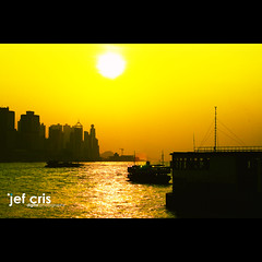 Gold Rush (jef cris) Tags: sunset sun silhouette yellow hongkong kowloon goldrush victoriaharbor tsimshatui canon50mmf14usm canon400d top20sunsetsofourhearts jefcrisyaneza